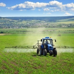 tractor crop spray farm fields herbicides