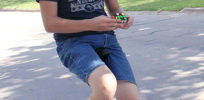 b most Rubiks cubes solved while riding a unicycle