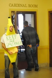 Anti-GMO protestor at Iowa organizing meeting as petition signatures were being gathered.