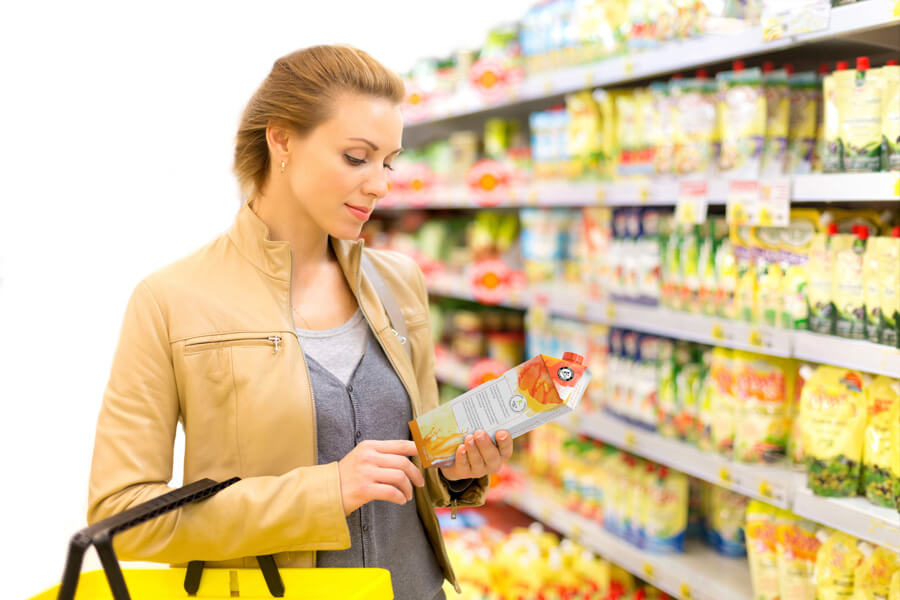 FDA Reading Food Label Woman Grocery Store Nutrition Label Changes