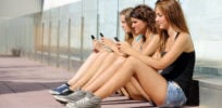 teenage girls with phones