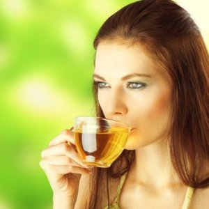 young female drinking green tea