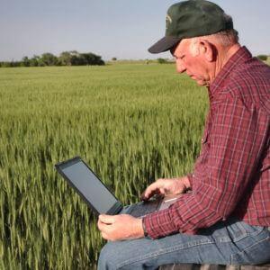 Tegnologie technology tech laptop farmer rekenaar