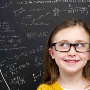 smart girl in front of blackboard