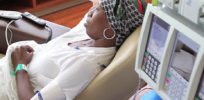 woman with headscarf getting chemo treatment article v e