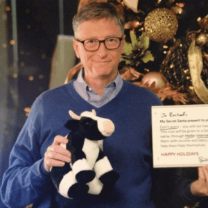 Bill Gates with stuffed cow e