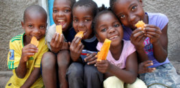 Children eating OFSP in Munguini