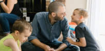 Adam Hayden plays the board game Pete the Cat with his sons Gideon and Noah.