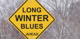 winter blues sign e x