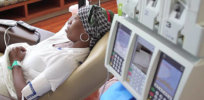 woman with headscarf getting chemo treatment article v
