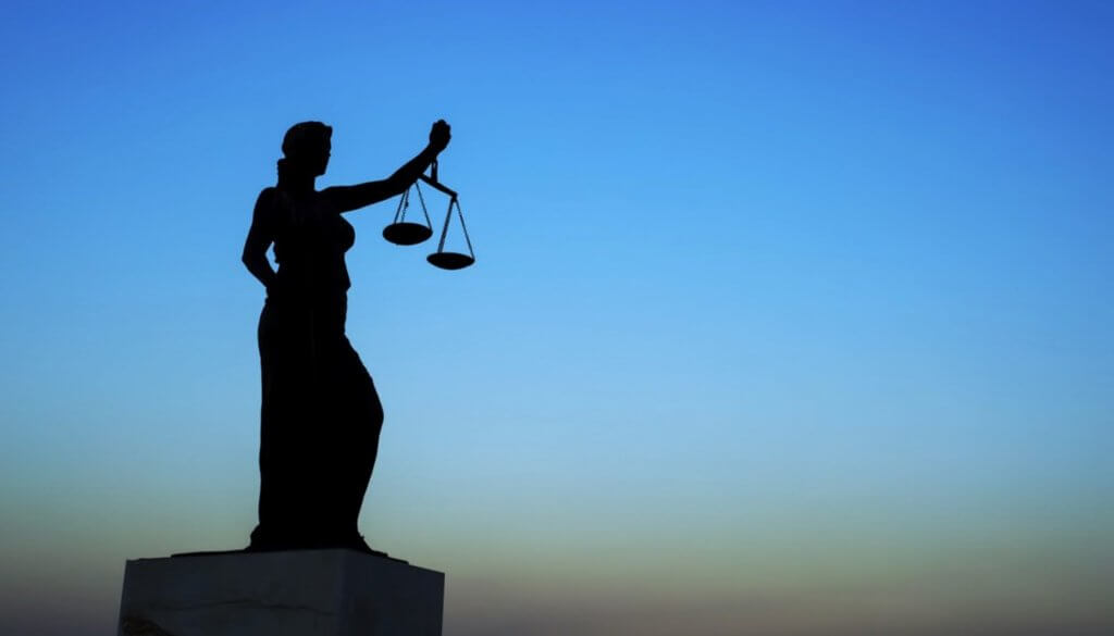 3-3-2019 fotolia scales of justice x