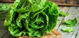 romaine lettuce on wooden chopping board