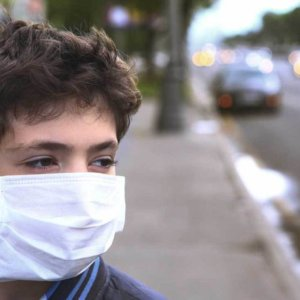 boy facemask outdoors x header