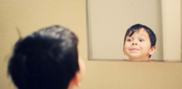 boy looking into mirror