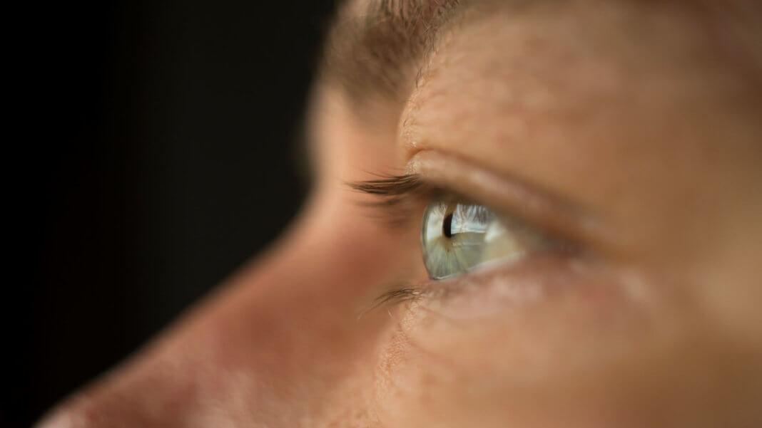 crispr close up mans blue eyes shutterstock x