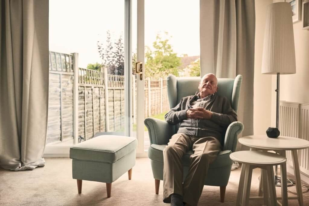 older man resting in an armchair