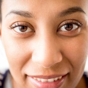 close up african female face with kind eyes