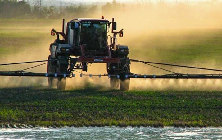 large farmer spraying crops can be used for dicamba articles