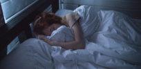 adult asleep bed