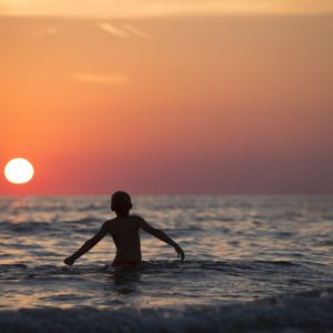 beach boy child dawn dusk horizon kid leisure