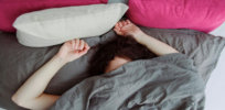 woman sleeping asleep alone bed x header x