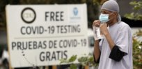 Vaccine conspiracy theories hold wide sway in government-skeptical Latino community