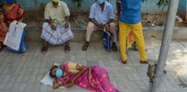 Photographs: As COVID crisis surges in India, tragedy spreads
