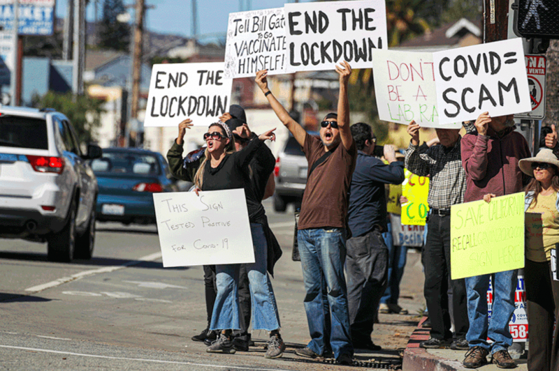 Protest at the Doger Statium COVID vaccination site. Credit: Irfan Khan/Los Angeles Times