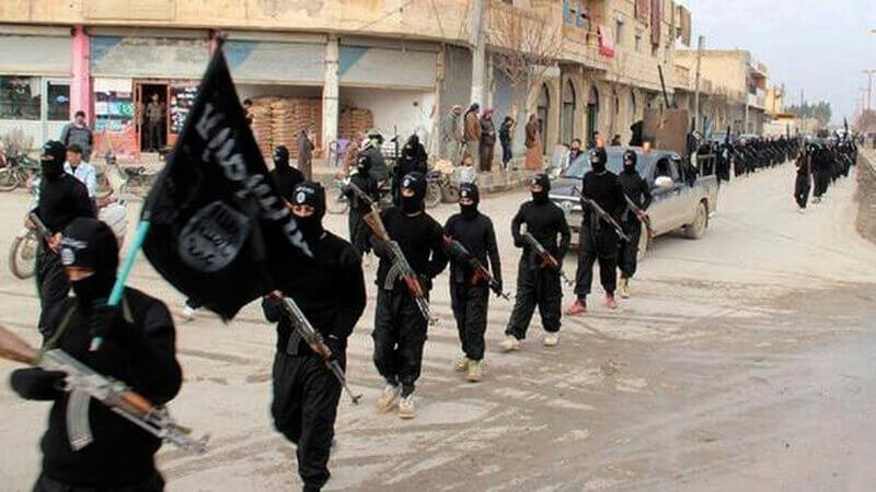 Fighters from the Islamic State of Iraq and the Levant (ISIL) marching in Raqqa, Syria. Credit: AP