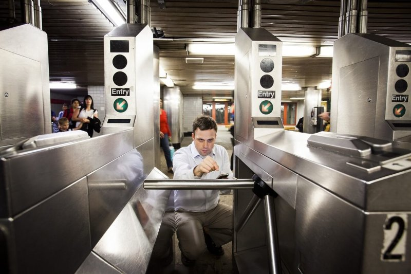 Researcher Christopher Mason from Weill Cornell Medical College collecting DNA samples at the 68th Street subway station in New York City. Credit: Katie Orlinsky/Wall Street Journal