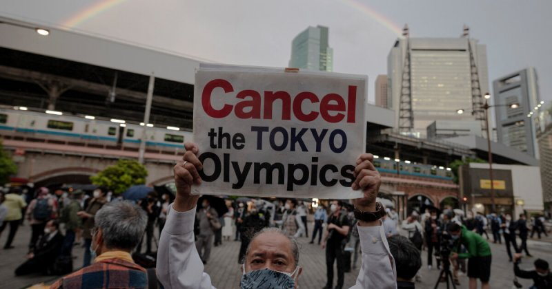 People take part in a protest against the hosting of the 2020 Tokyo Olympic Games in Tokyo on May 17, 2021. Credit: LA Times