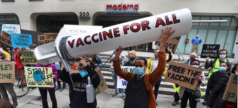 Scientists, community members, and activists held a march and rally outside Moderna's headquarters in Cambridge as part of a national week of action for fair access to vaccines. Credit: David L. Ryan/Boston Globe