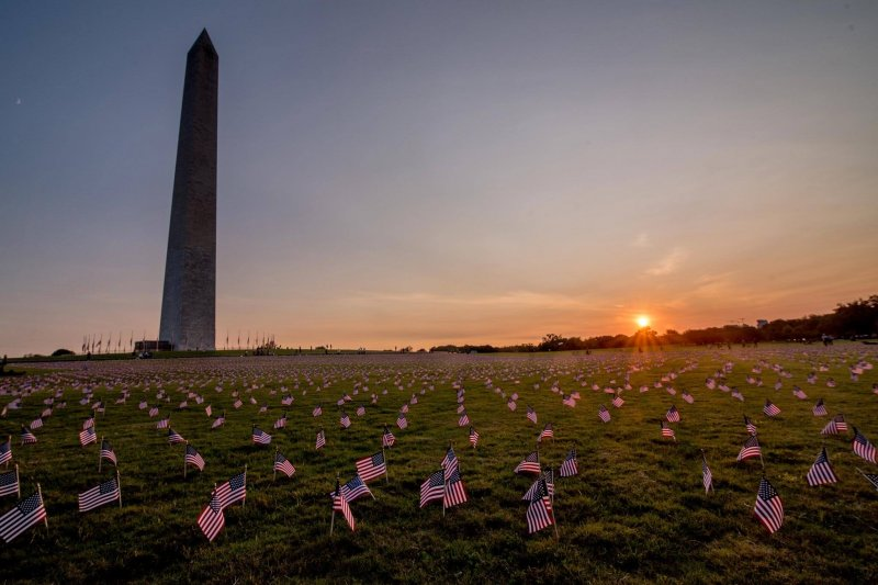 Flags surround the Washington Monument in a September memorial erected as the U.S. COVID-19 death toll passed 200,000. Credit: Angela N.