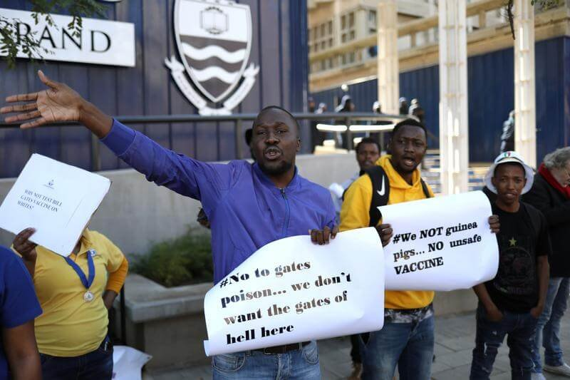 Protesters attend a demonstration against COVID vaccine testing on Africans, at Wits University in Johannesburg, South Africa. Credit: Siphiwe Sibeko/Reuters
