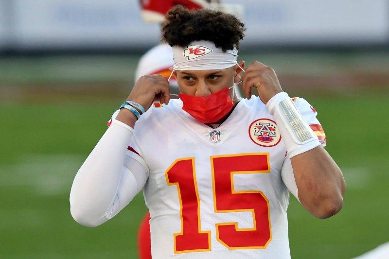 Kansas City Chiefs quarterback Patrick Mahomes wears a protective face mask. Credit: Jason Behnken/AP
