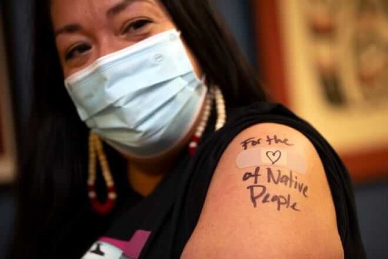 Abigail Echo-Hawk, chief research officer with Seattle Indian Health Board and a member of the Pawnee Tribe gets a shot of the Moderna COVID-19 vaccine. Indigenous Americans have been underrepresented in vaccine trials. Credit: Karen Ducey/Getty Images