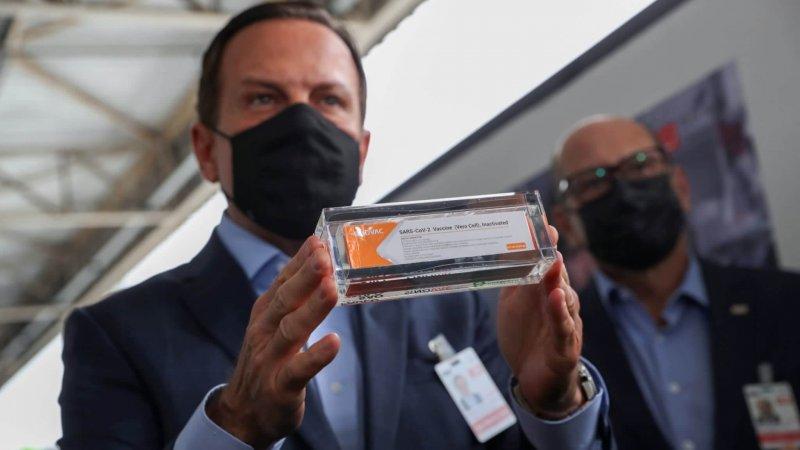 Sao Paulo Gov. Joao Doria holds a box of China's CoronaVac vaccine. Credit: Reuters
