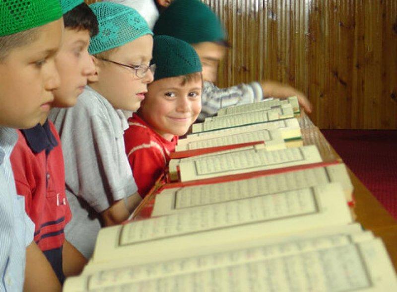 little boy reads quran