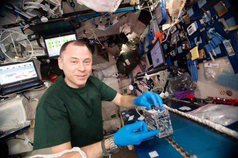 NASA astronaut Nick Hague using the miniPCR hardware to explore how space radiation damages DNA. Credit: NASA