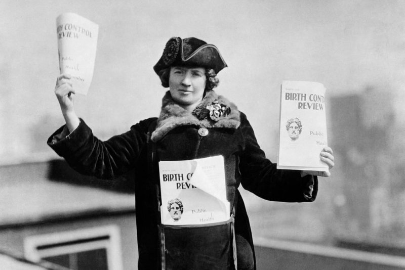 px kitty marion with copies of the birth control review in x