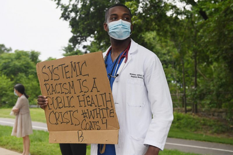 Protestor in St. Louis, MO after the death of George Floyd. Credit: STAT News