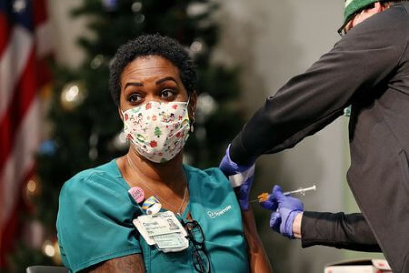 Demali Beard, a registered nurse, is given the COVID-19 vaccine. Credit: Mike Mulholland