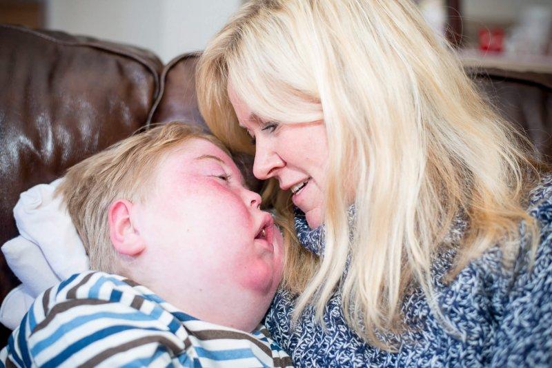 Maria Hopfgarten and her son Jacob Hallberg, who has a mitochondrial disease. Credit: Mary Elizabeth Graff